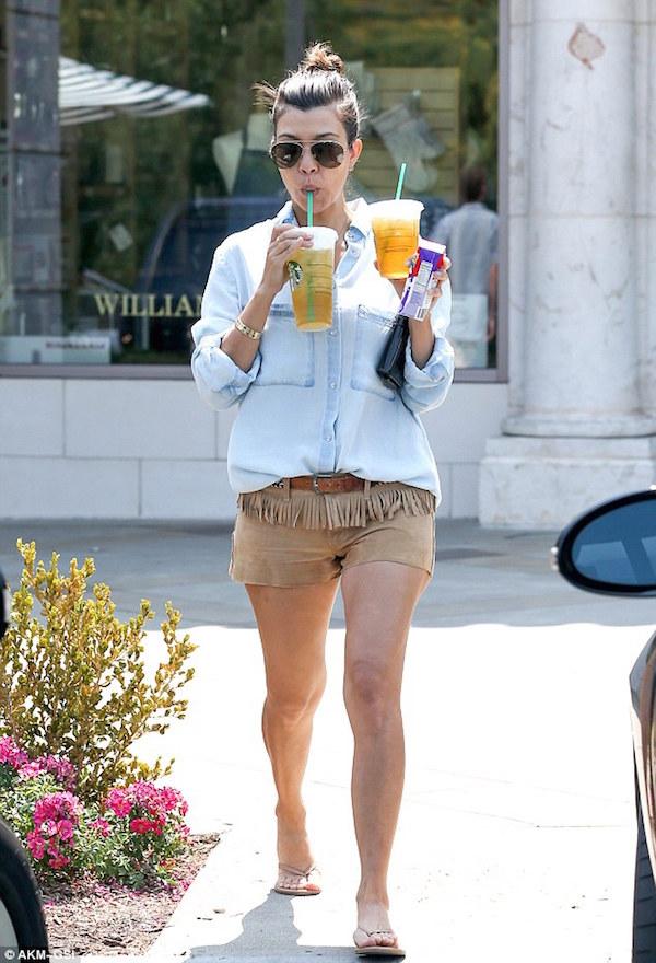 Kourtney Kardashian's keeping it chilled with these fringe shorts